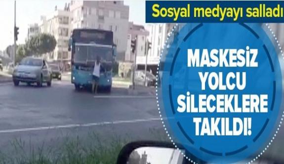 Maskesiz yolcu otobüs sileceklerine takıldı!.